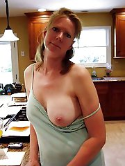 Delightful mature mistress playing alone